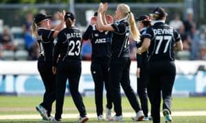 Hannah Rowe celebrates with teammates after taking the wicket of England's Nat Sciver