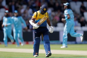 Kusal Perera leaves the pitch after being fired.