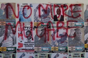 Mugabe election posters of are covered in opposition MDC slogans, in Harare, 2008.