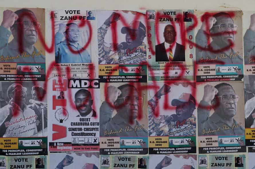 Mugabe election posters are covered in opposition MDC slogans, in Harare, 2008.