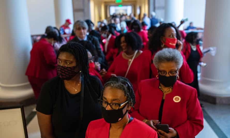 People stand in line to testify before the Texas legislature about proposed voting restrictions at the state capitol in Austin at the weekend.