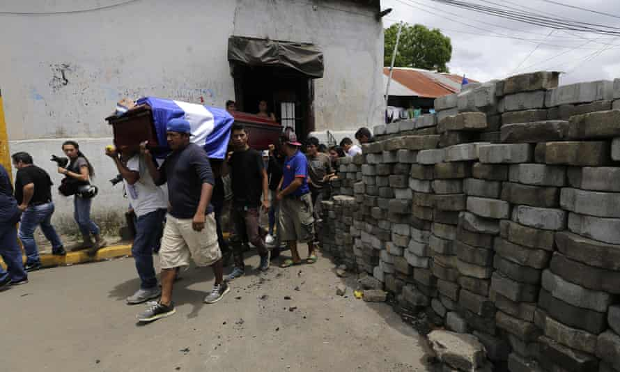 Friends and relatives of Jorge Carrión, 33, shot dead during protests against the government of President Daniel Ortega, carry his coffin during the funeral in Masaya on 7 June.