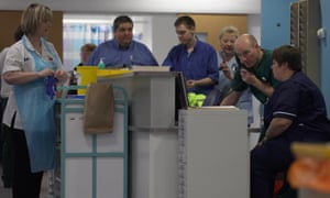 doctors and nurses around a work station at an A&E department in Birmingham