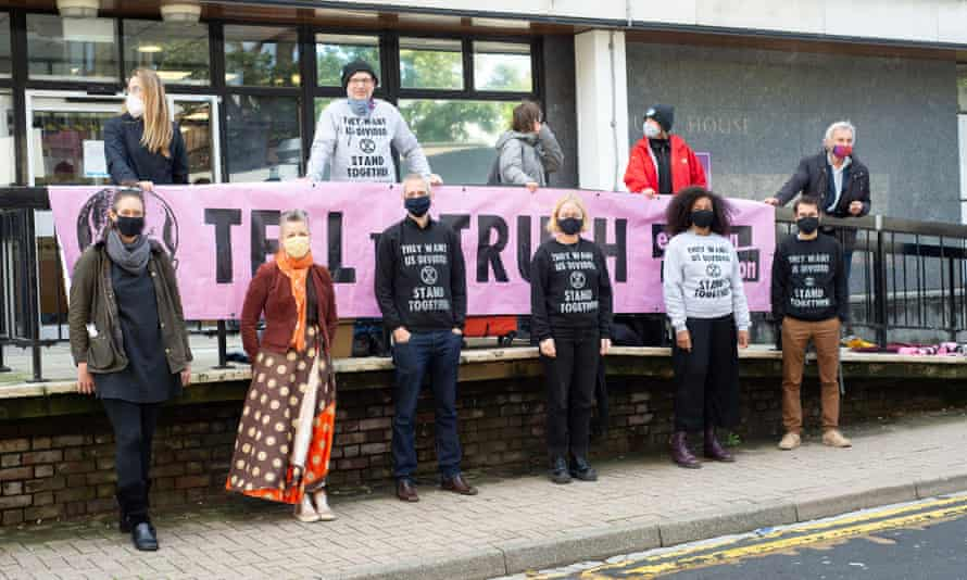 Extinction Rebellion protesters (bottom, left to right) Charlotte Kirin, Hazel Stenson, Caspar Hughes, Laura Frandsen, Elise Yarde and Amir Jones outside St Albans magistrates court.