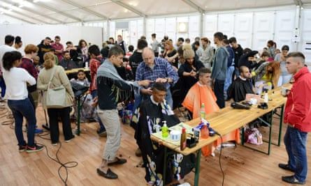 Hairdressers from Duesseldorf cut hair for free at a refugee accommodation centre.