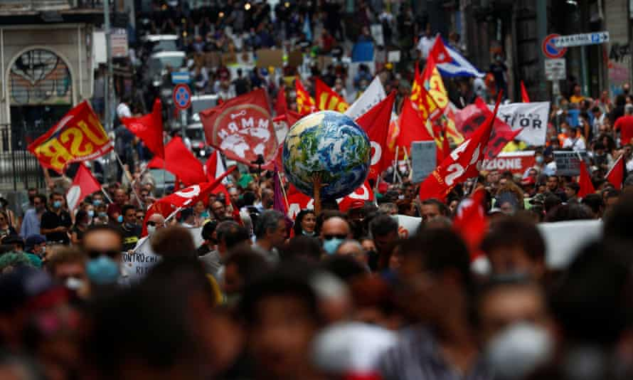 Protesters demand climate action as G20 ministers meet in Naples.
