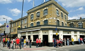 Fans outside the Arsenal Tavern in Blackstock Road, Finsbury Park.