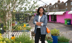 tashia tucker standing surrounded by plants at the box park in shepherds bush market