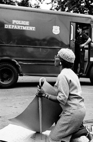 New York City. Brooklyn. 1963. A woman kneels in front of police at a civil rights protest.The photographs in this newly designed edition have been reproduced from the original negatives and using vintage prints created by Freed's master printer and widow, Brigitte Freed, as reference. Working closely with the archive, Freed's Black in White America series has never been published in such quality and detail before, and many images are also being published for the first time. The photographs in this large format edition are accompanied by text from Freed's original diaries from the time.