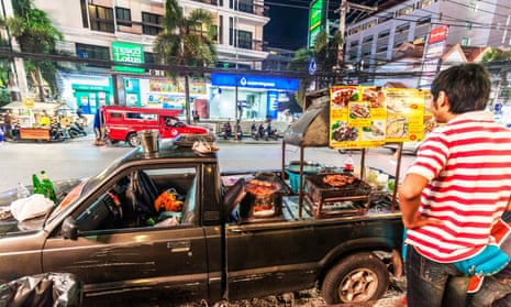 A car modified to also be a food cart serves dishes on Nimmanhaemin Road, in Chiang Mai, Thailand