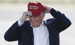 Donald Trump puts on his Make America Great Again hat