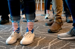 A voter wears a pair of Bernie Sanders socks while registering to vote at the Blair-Caldwell African American Research Library on Super Tuesday in Denver, Colorado.