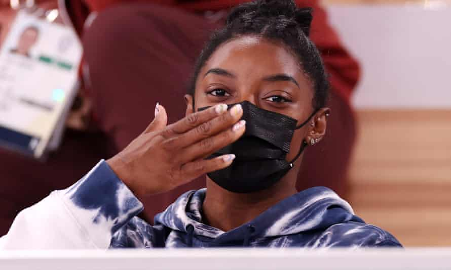 Gymnastics - Artistic - Olympics: Day 5<br>TOKYO, JAPAN - JULY 28: Simone Biles of Team United States blows a kiss whilst watching the Men's All-Around Final on day five of the Tokyo 2020 Olympic Games at Ariake Gymnastics Centre on July 28, 2021 in Tokyo, Japan. (Photo by Jamie Squire/Getty Images)