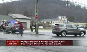 In a frame from video, police work at the scene of a fatal shooting at a car wash in Melcroft, Pennsylvania.