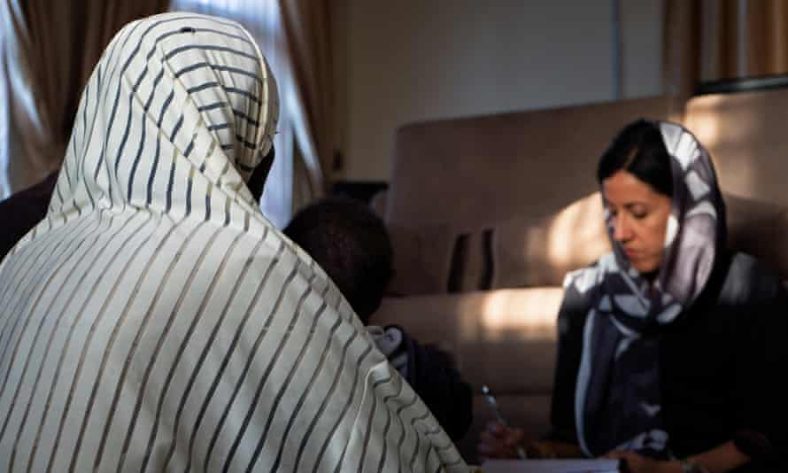 Azadeh Moaveni (right) interviews a woman in northeastern Nigeria.
