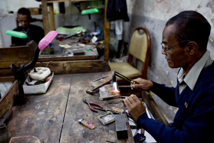 A jeweller crafts local gold into a ring at a jewellery workshop in Antananarivo, April 2016.