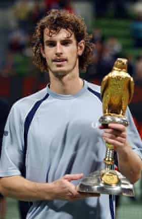 Britain's Andy Murray Britain holds the trophy as he poses for photographers after winning the final match against Stanislas Wawrinka of Switzerland in the Qatar Open ATP tennis tournament in Doha, 05 January 2008.