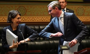 NSW premier Gladys Berejiklian bumps elbows with treasurer Dominic Perrottet after his budget speech
