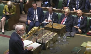 Boris Johnson listens to Jeremy Corbyn in the House of Commons on Tuesday.