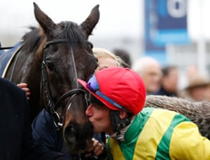 Robbie Power kisses Sizing John after the race.