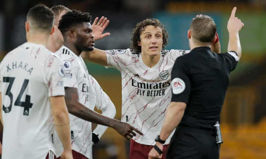 David Luiz is given his marching orders by referee Craig Pawson at the end of the first half.