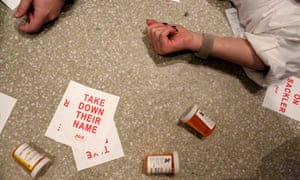 Protesters stage a 'die-in' as photographer Nan Goldin (not seen) and her organisation, Prescription Addiction Intervention Now (Pain) lead a protest at the Solomon R Guggenheim Museum in New York.