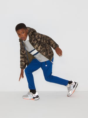 model wears camo quilted jacket, £32, and stripe top, £16, both johnlewis.com. Tracksuit bottoms, £26.95, gap.co.uk. Trainers, £42.99, by Adidas, from footlocker.co.uk.
