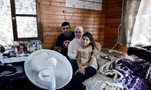 An Iraqi refugee family in their house on the Greek island of Lesbos.