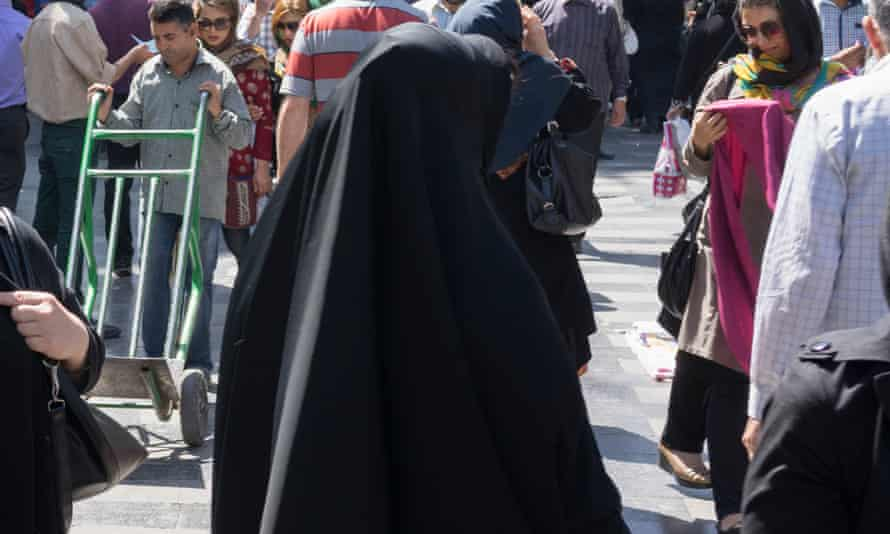 Covered woman wearing chador and hijab downtown Tehran.