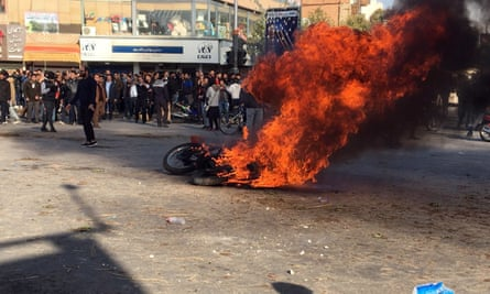 Iranian protesters clash in the streets following a fuel price increase in Isfahan, central Iran