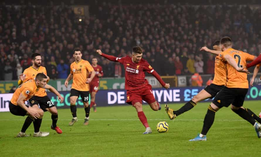 Liverpool's Roberto Firmino scores against Wolves.