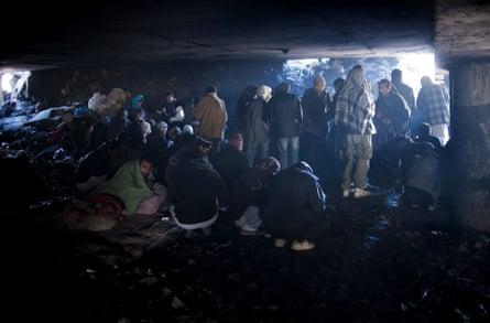 Drug addicts smoke opium under Kabul's Pul-e-Sokhta bridge.