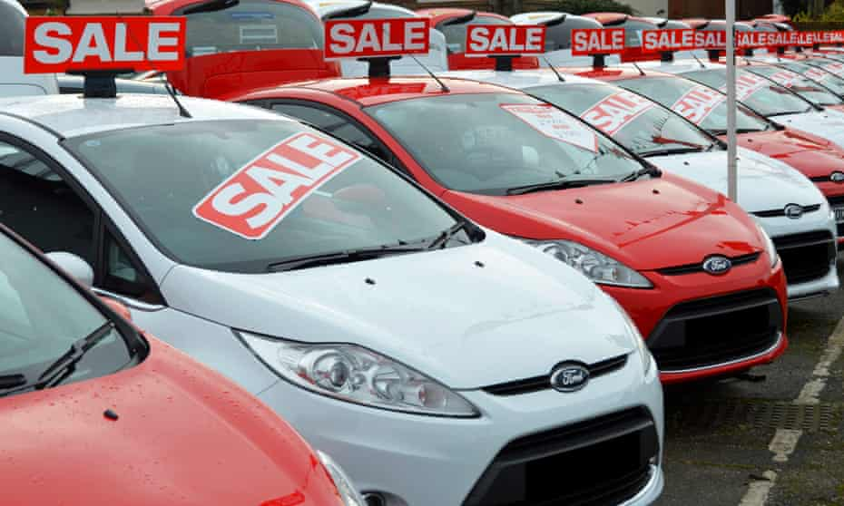 Cars awaiting buyers on a forecourt