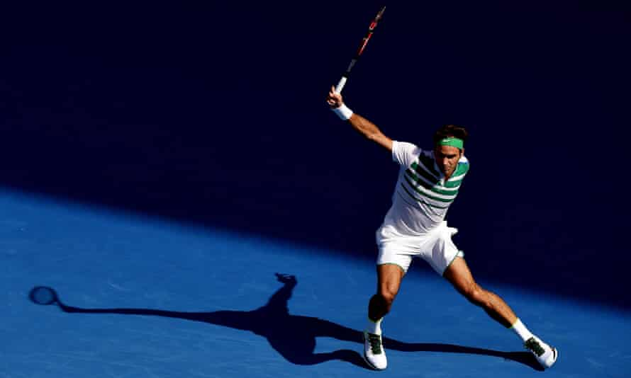 Roger Federer fires a backhand return during his 7-6 (7-4), 6-2, 6-4 win against Tomas Berdych.