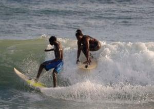 Khadjou surfs with her friend Madicke Mbengue