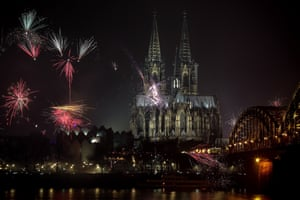 Fireworks illuminate the sky next to the Cologne Cathedral in Cologne, Germany