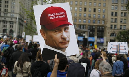 In New York City activists at an anti-Trump 'March for Truth' satirise the US-Russia relationship with a Putin poster.