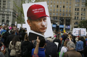 A demonstrator holds up a sign of Vladimir Putin during the anti-Trump march in New York.