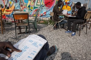 Students at work at the now defunct 'Jungle' refugee camp in Calais, France, in September 2016