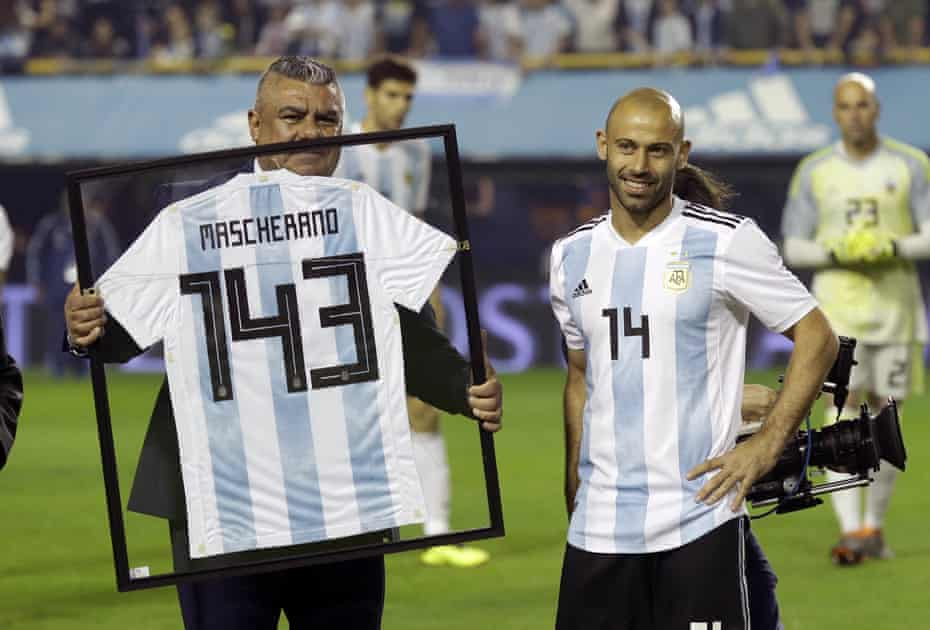 Mascherano is presented with a jersey for playing 143 games for the Argentinian team before the recent friendly against Haiti in Buenos Aires.