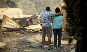 Eyed Jarjour, left, comforts a neighbor who lost her Jolette Ave. home to the Saddleridge fire (AP Photo/Noah Berger)
