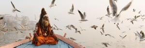 A sadhu (holy man) on a boat in Varanasi, India
