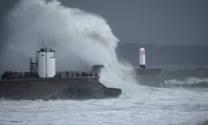 Waves caused by Storm Frank batter coast of south Wales