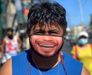 A man wears a face mask with a picture of the boxing icon Manny Pacquaio in Las Piñas, south of Manila