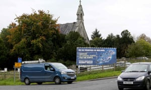 Traffic passes an anti-Brexit billboard on a road between Newry in Northern Ireland and Dundalk in the Republic