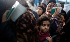 Palestinian refugees wait to receive aid at a UN food distribution center in Al-Shati refugee camp in Gaza City on 15 January 2018.