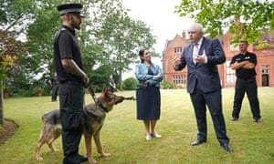 Boris Johnson and Priti Patel with police officers