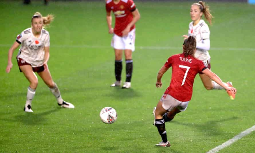 Manchester United's Ella Toone (right) scores the only goal of the game against Arsenal at Leigh Sports Village.