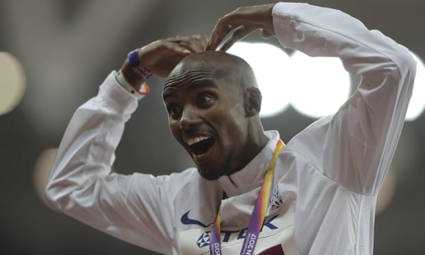 Mo Farah shows his delight after receiving his gold medal for winning the 10,000m final on day one of the World Athletics Championships.