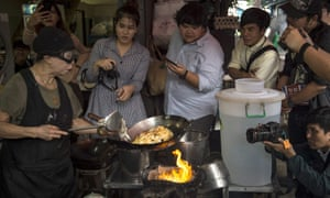 Jay Fai cooks in her kitchen after her street-side eatery was recognised with a Michelin star.